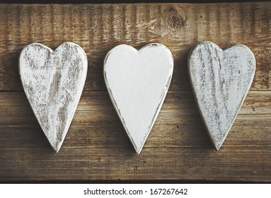 handmade rustic hearts  over wooden background