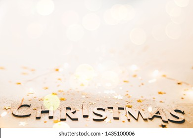 Handmade rustic wooden letters on white paper background. Christmas background.