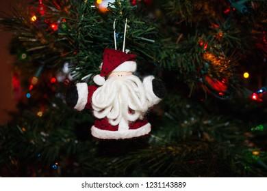Handmade Santa Ornament on a Christmas Tree
