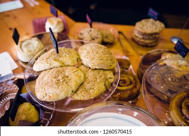 Handmade scones on a plate at a local bakery featuring organic and homemade bakery items.