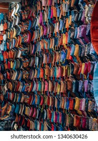 handmade shoes in a shop in the souks of marrakech, morocco