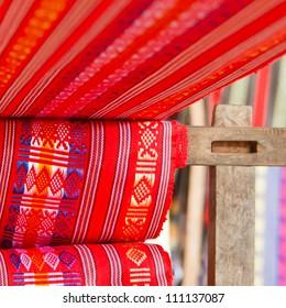 Handmade silk textile industry, silk scarf on a old machine (Vietnam)