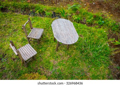 Handmade small rustric table and chairs outdoors