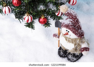 Handmade snowman in front of a Christmas tree