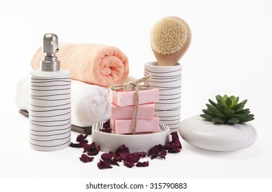 Handmade Soap  with bath accessories on white background