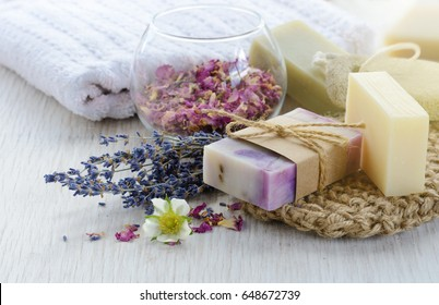 Handmade Soap with bath and spa accessories. Dried lavender and rose petals - Shutterstock ID 648672739