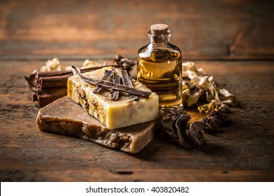 Handmade soap with cinnamon and vanilla on a wooden background