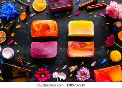 handmade soap, natural cosmetics and herbs on a black background