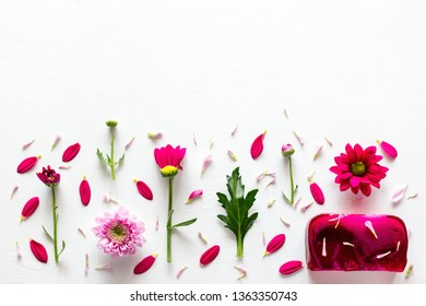 handmade soap spa of herbs and flowers with petals with place for text on a white background
