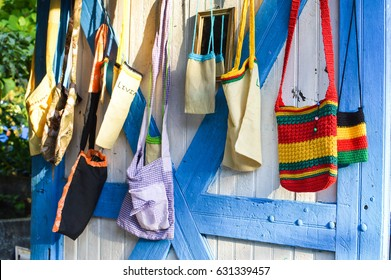 "Handmade souvenir bags in Livingston, Guatemala. Central America. The word ""ivin""� visible on one of the bags is for ""Livingston"" - the name of the town."