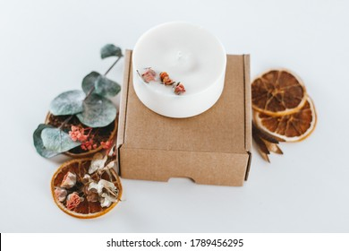 Handmade soy wax scented candles. Aromatherapy, decoration, dried flower and fruit scented candles. Eco package, cardboard box.