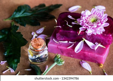 handmade spa flower soap and bottles with cosmetic oil close up