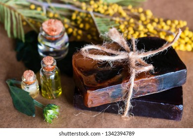 handmade spa flower soap and bottles with cosmetic oil close up on a background of flowers