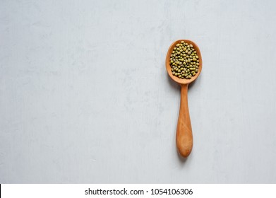 Handmade spoons. One wooden spoon with grains of lentils.