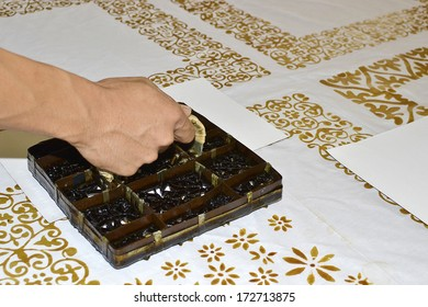 Handmade stamping batik pattern on white cloth