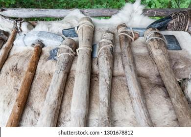 Handmade stone age axes in a row