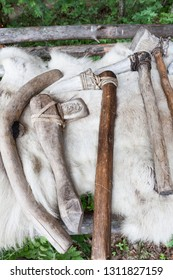 Handmade stone age axes in a row