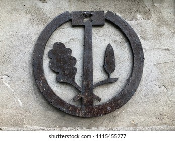 handmade symbol of blacksmith on pattern wall