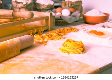 Handmade tagliatelle noodle angle view of rustic kitchen tools and all ingredients  - Fresh italian pasta hand made regional specialty - Concept of traditional healthy  food