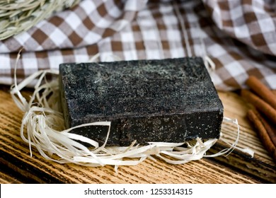 Handmade tar soap in a rustic style on wooden background