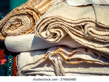 Handmade textile - natural fabric of flax and cotton tapestry in vintage style. Canvas and burlap closeup - homespun fabric of handwork. Ethnic textile for decoration of home interior.