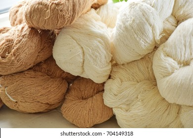 Handmade thai Cotton yarn for the Cotton flower. The raw organic yarn on the table.The beautiful color of organic handmade Cotton. The raw organic cotton yarn Natural color of organic handmade.