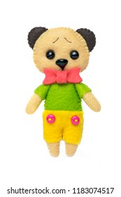A handmade toy bear in a shirt and shorts on a white isolated background.