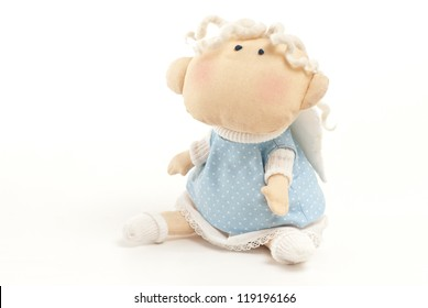 handmade toy cute little angel boy isolated