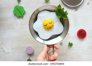 Handmade toy felt egg on the table.