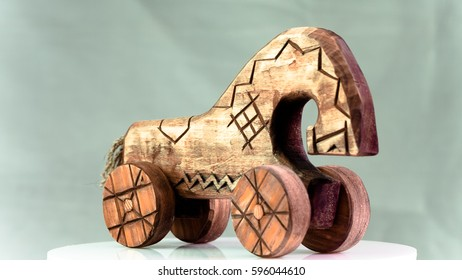 Handmade toy horse on wheels made in Russian style of wood. Object photo.