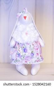Handmade toy rabbit girl  in a flower dress