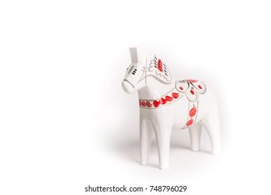 A Handmade Traditional Swedish Wooden Dala horse,  Dalecarlian, isolated on white background