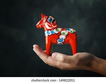 """A Hand-made traditional wooden Dalecarlian Horse (""""Dalahast&quo t;) is a symbol of Swedish Dalarna and Sweden in general."""