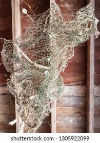 Handmade trawl net fishing mobile.Wall or window hanging.Nature decor background.