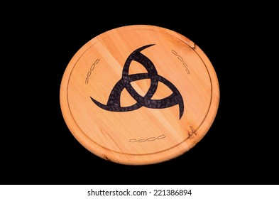 Handmade Typical Tribal Black Sign on a Wooden Surfface