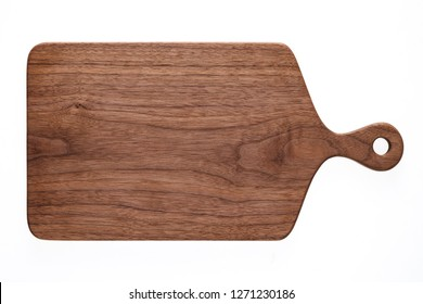 Handmade walnut chopping board. Walnut chopping board texture background.