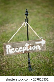 Handmade wedding sign pointing towards reception