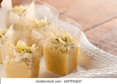Handmade white chocolate and lime dessert on wooden background