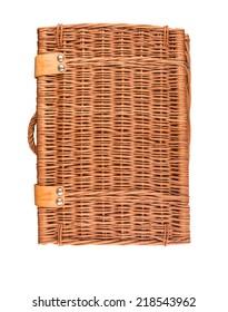 Handmade wicker picnic basket over white background