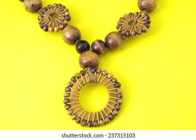 Handmade Wood Collar Necklace on a Colored Background