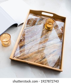 Handmade wood serving tray decorated with marble effect. Epoxy resin art decor. Natural colors like brown. gold, black, beige. Background for DIY master class. Fluid art or acrylic decorative tray
