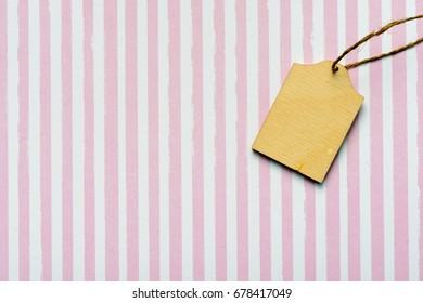 Handmade wooden label on textile background as greeting card