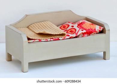 Handmade wooden miniature sofa for dollhouse.
