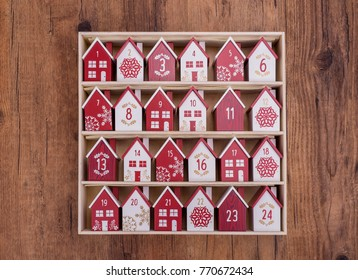 handmade wooden perpetual calendar in a form of a house