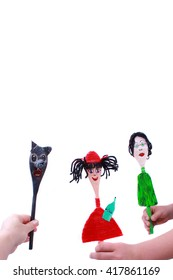 Handmade wooden puppet from spoon on a white background