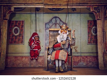 Handmade wooden puppet theater. King and Jester. Selective focus