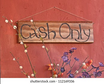 Handmade wooden sign that says Cash Only