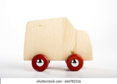 Handmade wooden toy truck isolated on white background