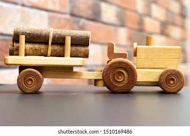 handmade wooden tractor and trailer used as decorative toy in the interior
