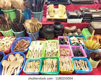 Handmade wooden, vintage kitchen utensils for sale at the market. Various wooden kitchen tools. Different wooden tableware. kitchen tools kitchen tools.
